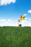 Happy young woman with colorful balloons Royalty Free Stock Image