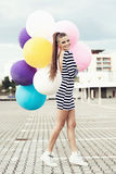 Happy young woman with colorful latex balloons Royalty Free Stock Images