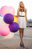 Happy young woman with colorful latex balloons Royalty Free Stock Photo