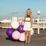Happy young woman with colorful latex balloons, outdoor Royalty Free Stock Photo