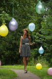 Young woman with colorful latex balloons Stock Photo