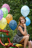 Young woman with colorful latex balloons Royalty Free Stock Photos