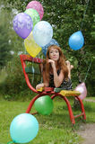 Young woman with colorful latex balloons Stock Photography