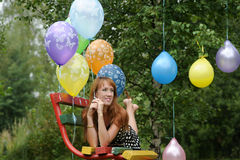 Young woman with colorful latex balloons Stock Images