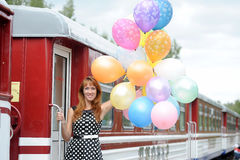 Young woman with colorful latex balloons Stock Photos