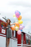 Young woman with colorful latex balloons Royalty Free Stock Images