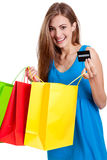 Happy young woman with colorful shopping bags visa isolated Royalty Free Stock Photography