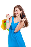 Happy young woman with colorful shopping bags visa isolated Royalty Free Stock Photos