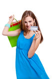 Happy young woman with colorful shopping bags visa isolated Stock Photo
