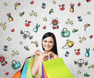 A happy young woman with the colourful shopping bags from the fancy shops. Royalty Free Stock Photo