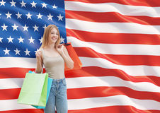 A happy young woman with the colourful shopping bags from the fancy shops. Stock Photos