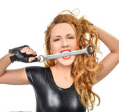 Happy young woman contructor worker with construction tool wranc Royalty Free Stock Image