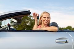 Happy young woman with convertible car key Stock Image
