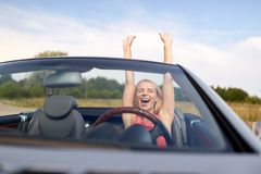 Happy young woman in convertible car Stock Photo