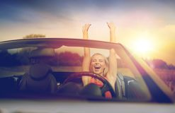 Happy young woman in convertible car. Travel, summer holidays, road trip and people concept - happy young woman in convertible car enjoying sun stock images