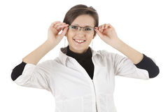 Happy young woman correcting glasses Royalty Free Stock Images