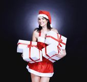 Happy young woman in costume of Santa Claus with lots of Christ. Mas shopping. isolated on black Stock Photos
