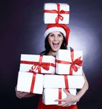 Happy young woman in costume of Santa Claus with lots of Christm. As shopping. isolated on black Stock Image