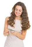 Happy young woman counting money Stock Photography