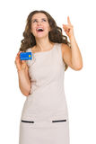 Woman with credit card pointing on copy space Royalty Free Stock Photo