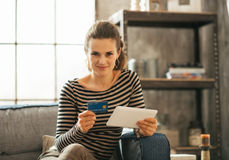 Happy young woman with credit card and tablet pc Royalty Free Stock Photos