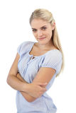 Happy young woman with crossed arms Stock Images