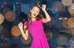 Happy young woman in crown over night city Stock Photos