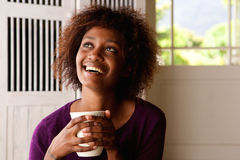 Happy young woman with cup of coffee Royalty Free Stock Photo