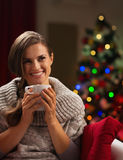 Happy young woman with cup of hot chocolate Royalty Free Stock Photo