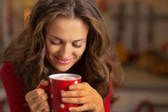 Happy young woman with cup of hot chocolate Royalty Free Stock Images