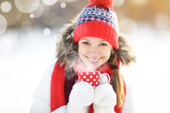 Happy young woman with a cup of hot tea in winter  walk Royalty Free Stock Images