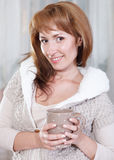 Happy young woman with cup of tea (or coffee) Royalty Free Stock Photo