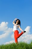 Happy young woman dancing Stock Photography