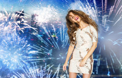 Happy young woman dancing over firework at city Royalty Free Stock Images