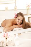 Happy young woman in day spa Stock Photos