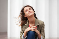 Happy young woman daydreaming Royalty Free Stock Photos
