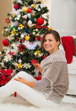 Happy young woman decorating Christmas tree Royalty Free Stock Photos