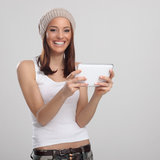 Happy young woman and digital tablet Royalty Free Stock Photo