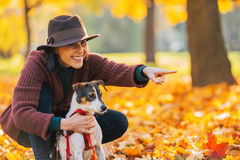 Happy young woman dog outdoors Royalty Free Stock Photography
