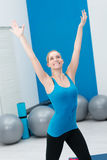 Happy young woman doing aerobics exercsies Stock Photos