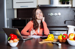 Happy young woman is doing banking and administrative work holdi Royalty Free Stock Photo