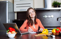Happy young woman is doing banking and administrative work holdi Stock Photography