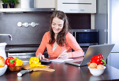 Happy young woman is doing banking and administrative work holdi Royalty Free Stock Image