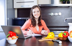 Happy young woman is doing banking and administrative work holdi Royalty Free Stock Photography