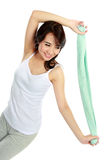 Happy young woman doing exercise Stock Images