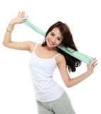 Happy young woman doing exercise Stock Image