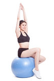 Happy young woman doing exercises with fitness ball Stock Images