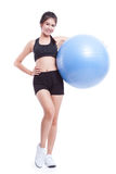 Happy young woman doing exercises with fitness ball Royalty Free Stock Photo