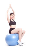 Happy young woman doing exercises with fitness ball Stock Photos