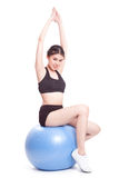 Happy young woman doing exercises with fitness ball Stock Photography